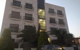 شقة فارغة بموقع مميز بدير غبار - عمان